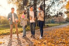 Студенты в парке осени Стоковое Изображение