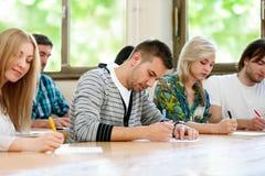 Студенты в университете Стоковая Фотография