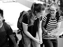 Студенты идя и говоря единение Стоковая Фотография RF