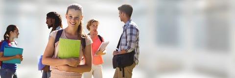 Студенты перед запачканной предпосылкой стоковые фотографии rf