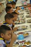Студенты Таиланда едят стоковое изображение