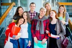 Студенты университета на лестнице Стоковая Фотография