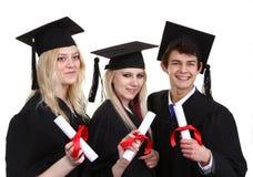 3 студент-выпускника держа перечени Стоковое фото RF