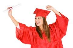Студент-выпускник: Веселя женщина смотрит диплом Стоковое Изображение