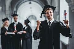 Студент-выпускник мужчины в университете Стоковые Фотографии RF