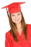 Студент-выпускник: Портрет студента в красных крышке и мантии Стоковая Фотография