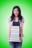 Студент девушки с книгами на белизне Стоковые Фотографии RF