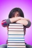 Студент девушки с книгами на белизне Стоковые Изображения
