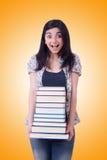 Студент девушки с книгами на белизне Стоковые Изображения RF