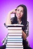 Студент девушки с книгами на белизне Стоковое Изображение