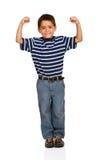 Студент: Мальчик делает мышцы Стоковые Изображения RF