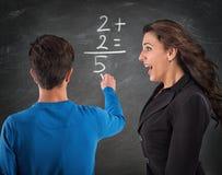 Студент осла и отчаянный учитель стоковая фотография rf