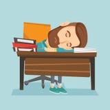 Студент спать на столе с книгой Стоковое фото RF