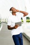 Студент с цифровой таблеткой Стоковые Фото