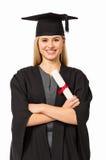 Студент университета в мантии градации держа сертификат стоковые фото