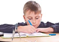 Студент для того чтобы сделать домашнюю работу Стоковое Фото
