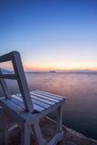 Стул на заходе солнца на утре Стоковые Изображения