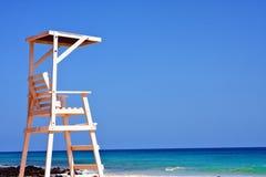 Стул предохранителя жизни на пляже Стоковое Фото