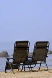 Стулья на пляже Стоковая Фотография