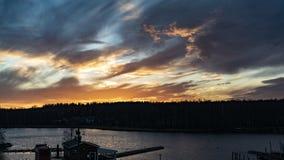 стыкует заход солнца стоковое фото rf
