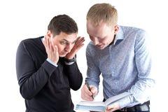 2 сумашедших businessmans на белой предпосылке Стоковые Изображения RF