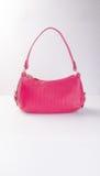 сумка или сумка моды красного цвета на предпосылке Стоковые Изображения RF