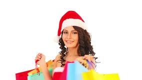 Сумка красного цвета рождества продажи Женщина покупок в шляпе Санты акции видеоматериалы