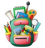 Сумка школы с школьными принадлежностями Стоковые Фотографии RF