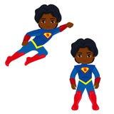 Супергерой мальчика в полете и в положении стоя Стоковое Изображение RF