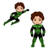 Супергерой мальчика в полете и в положении стоя Стоковое Фото