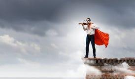 Супермен с скрипкой Стоковое Изображение