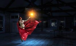 Супер женщина в небе Мультимедиа стоковая фотография rf