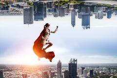 Супер женщина в небе Стоковая Фотография