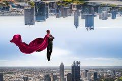 Супер человек в небе стоковая фотография rf