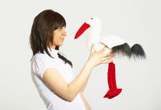 супоросая женщина игрушки аиста Стоковая Фотография