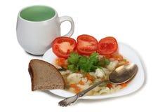 Суп закуски на предпосылке плиты Стоковое Изображение RF