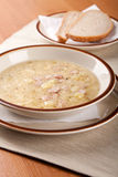 Суп картошки с сосиской и хлебом стоковые изображения rf