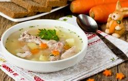 Суп пасхи с кроликом и морковами Стоковая Фотография
