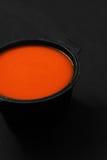 Суп томата в блюде литого железа стоковая фотография rf