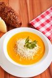 Суп тыквы на деревянном столе Стоковое Изображение