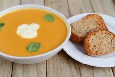 Суп тыквы с хлебом Стоковая Фотография RF