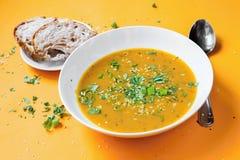 Суп тыквы, хлеб Стоковые Изображения RF