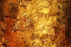 Сусальное золото предпосылка стоковая фотография