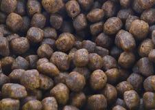 Сухая текстура корма для домашних животных Стоковые Изображения