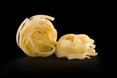 сухие макаронные изделия сырцовые 2 гнездя Стоковые Изображения