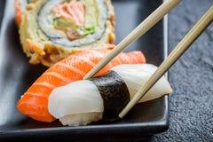 Суши съеденные с палочками Стоковые Фото