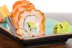 Суши maki Калифорнии с оранжевым masago Стоковые Фото