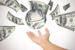 Сфера денег в руке Стоковое фото RF