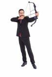 Сфокусированный бизнесмен снимая лук и стрелы Стоковое фото RF