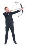 Сфокусированный бизнесмен снимая лук и стрелы Стоковое Изображение